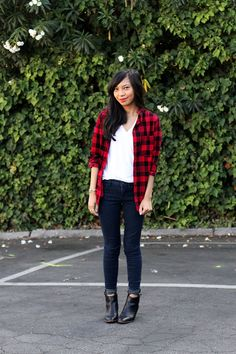 A red plaid shirt and skinny jeans