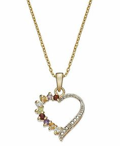 A lot of love to give. Victoria Townsend's open heart pendant makes a colorful statement with round-cut amethyst, blue topaz, citrine and peridot accents, as well as gorgeous garnet.