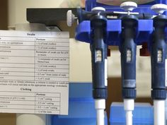 Instructions sit next to pipettes http://www.usatoday.com/story/news/2015/07/16/untested-rape-kits-evidence-across-usa/29902199/