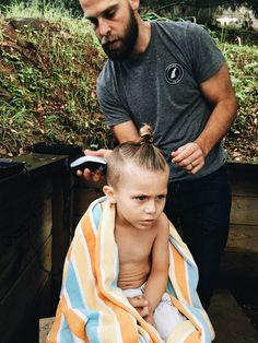 """Step-by-Step tutorial on how to create the shaved """"man bun"""" side swept hair on your child. New Haircuts For Boys, Boy Haircuts Long, Boys Long Hairstyles, Kids Braided Hairstyles, Man Bun Haircut, Viking Haircut, Baby Haircut, Toddler Boy Long Hair, Cute Toddler Boy Haircuts"""