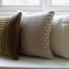 Hand-Knitted Cushions. Could make then cushion covers and use a mixture of patterns and colours.