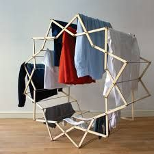 Graduate designer Aaron Dunkerton has developed an expandable clothing airer that unfolds into a star shape to create more space for hanging wet garments