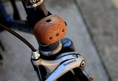 Wooden Bike Accessories - The best timbered adornments for your ride // Add some class. Mountain Bike Accessories, Cool Bike Accessories, Dirt Bike Helmets, Wooden Bicycle, Bike Logo, Bicycle Painting, Bike Photography, Push Bikes, Bike Shoes