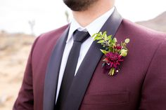 Joshua tree styled wedding shoot groom maroon suit with long black tie and burgundy boutonniere, slim fit burgundy wedding tuxedo