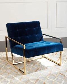 Modern chair in blue velvet.