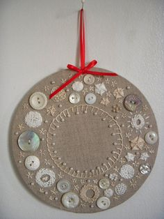 Here is wreath number two. It also makes use of some vintage buttons, but with a far different effect. I wanted to play with texture so I used my fancy new stitches and some buttons and faux pear...