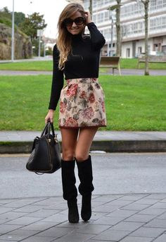 Black blouse with flowers printed short skirt and black leather hand bag and long boots