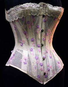 Summer corset with embroidery, late 19th C.  Okay, maybe I'll make something like this. This example makes me wonder if the loose weave cotton I have would be strong enough for a corset. It would be neat to try if it did.