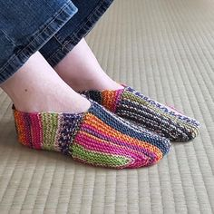 These brightly colored rainbow slippers are the perfect addition to your footwear collection.