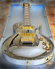 I WANT IT!! ... Chrome Les Paul with gold hardware...nice (Inset). CLICK THROUGH the GRAPHIC to experience thrilling critically acclaimed/fan approved new music now!!  Also, VISIT WWW/REVERBNATION.COM/TEDPALMER for FREE downloads and stuff. #beautifulguitars