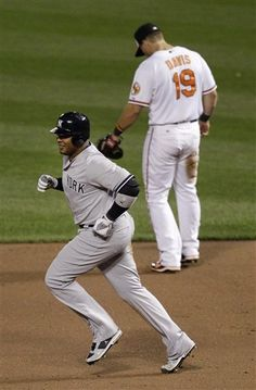 GAME 4: Monday, April 9, 2012 - New York Yankees' Andruw Jones rounds the bases past Baltimore Orioles first baseman Chris Davis after hitting a solo home run in the sixth inning of a baseball game in Baltimore. New York won 6-2. (AP Photo/Patrick Semansky)