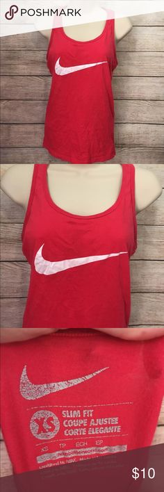 "Nike Dri-FIT Women's XS red Racerback Tank Top Measures 18"" from armpit to armpit  Measures 26"" from shoulder seam to bottom hem  EUC Nike Tops Tank Tops"