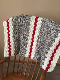 This crochet baby blanket shares a color scheme with the ever popular sock monkey stuffed toys - so cute!