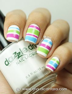 Pastel stripes of purple, green and blue on white base nail art design