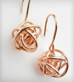 "Rose Gold Love Knot Drop Earrings (by Natasha Grasso) - A tiny reminder of all the twists and turns taken on the rollercoaster of love. These love knot drop earrings are handmade from 14k rose gold and features 3/8"" knot studs and hook earwires."