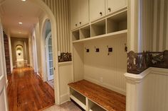 mud room: hooks, cupboards, cubbies, bench with storage