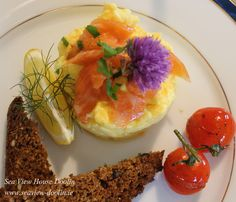 Doolin free-range eggs, Burren smoked salmon, Toasted soda bread with dulisk, tomato sautéed in white wine and Balsamic vinegar's, Chive, fennel and Parsley.