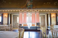 Dresses hanging in Semple Mansion's Grand Palladian Ballroom