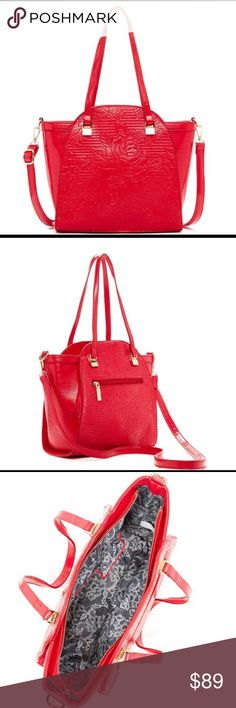 """🌹MUST HAVE❣️ROSE Patterned Bag😍 This beautiful red rose patterned bag has two handles (8.5"""" drop) and a detachable shoulder strap (26"""" strap drop). The bag closes with a zip top and features an additional pocket on the exterior of the bag. The interior has one wall zip pocket and two smaller slip pockets. The size is approximately 11""""H x 11""""W x 4.25""""D. Thank you 🙌🏽 for shopping 🛍 my closet❣️Smoke free 🚭 dog loving 🐶 home 🏠. Please ask questions ❓ and feel free to make offers 💵💳💰…"""
