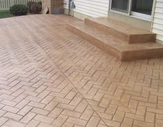 Stamped concrete patio-talked about this idea last night and adding a fountain