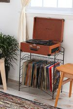 Crossley tan Keepsake turntable and black record stand by Urban Outfitters..It's on the list!