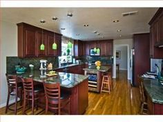 Love the cherry tinted #brown kitchen