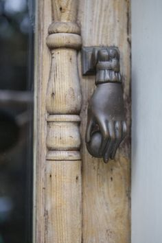 Using a metal hand to knock the door because your own hand simply won't do? How fab!