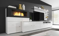 Home Innovation - Living room set with bioethanol fireplace finished in matt white and white gloss lacquered. Measures: 290 x 170 x 45 cm depth - Rattan Furniture SHOP UK Interior Furniture Biofuel Fireplace, Bioethanol Fireplace, Home Entertainment, Home Decor Furniture, Furniture Design, Tv Set Design, Living Room Tv, Home Interior Design, Interior Decorating