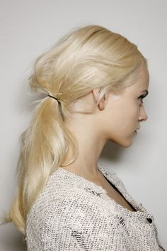 ponytails are THE most 'in' thing on the fashion runways right now. I really liked the hair teased a little, then put in a ponytail. It gives it a little edge.