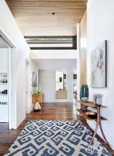Contemporary White Foyer with Patterned Wool Rug
