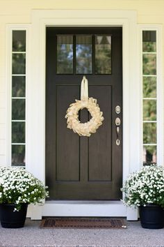 This is similar to Justin and Is new front door, but ours is a deep red. Im now wishing we wouldve chosen this dark color, but the sun hitting it might be bad. I will accessorize our entry somewhat like this! :) SPRING!!