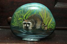 painting of raccoon on rock by Ron Clifford