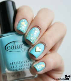 Gold glitter over turquoise <3 And of course the heart stud is sooo cute. :)