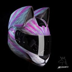 For those out there who like both cats and motorbikes, we have something special for you! Russian company 'Nitrinos Motostudio' has started making helmets with cat ears, so you can look like one cool feline when you take the Harley out for a spin. Dubbed 'Neko Helmets' the unusual headgear is available in 12 different designs, from sleek black to psychedelic stripy purple and more! Check it out!