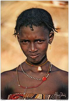 Africa | Bororo girl from the Garoua region of northern Cameroon || Scanned postcard, photo by Alain Denis