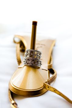 We love this ring shot! And the shoe! #BreakersWedding
