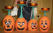Pumpking Wine Candles: Paint with acrylic paint. Allow to dry completely then spray with acrylic sealer spray.  Patterns for faces on website.    Glue votive holder to the bottom of the glass. Insert tea light candle into votive.