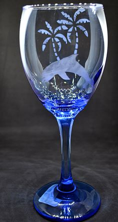 Check out this item in my Etsy shop https://www.etsy.com/listing/493797473/etched-wine-glass-dolphin-wine-glass