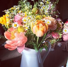 The most beautiful wedding flowers in the world! Coral peonies with yellow and white flowers in a loose woodland style.