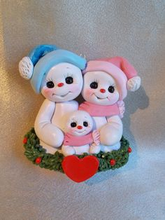 Family Christmas ornament snowman polymer clay snow family: By Clayqts via Etsy Her stuff is adorable!