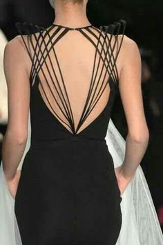 Jean Paul Gaultier, this is so cool. Would be cooler if the straps were tight on the shoulders, but the idea is cool.