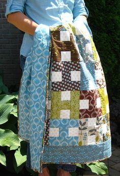 """H"" block baby quilt by Sharon Holland. Also, if the white squares were the color of the adjacent block instead of white, this quilt would look like puzzle pieces!"