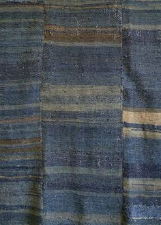 This beautiful, indigo dyed cotton textile was used as a sleeping mat, either by itself or as a mat on top of which a futon would be placed. It is a sakiori textile, or a rag woven textile.