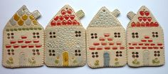 Cute little ceramic cottages, to hang in your home.