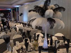Ostrich feathers centerpiece should we do red, since chair covers are Gonna be black and white already?