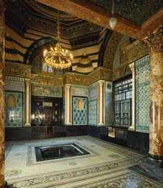 Leighton House in Holland Park, London. I visited here today and wow wow wow! This is the Arab Hall complete with gilded dome, fulled tiled walls, the most amazing snug seats with stunning lattice work and of course an indoor fountain! I can't find a photo to do this room justice.