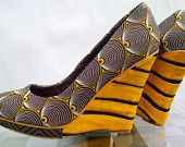 African Print has permeated all facets of fashion. I love all the ways it pops up, but I especially love the print on shoes because it's such a refreshing and nouvelle concept. An African printed s. African Wear, African Fashion, African Inspired Clothing, African Clothes, Striped Shoes, Fabric Shoes, Bold Fashion, Dream Shoes, Brown Shoe