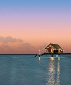 Ocean hut sunset