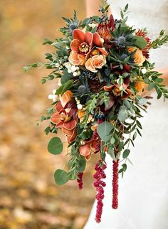 This deep orange bouquet seems perfect for fall, complete with some fruits of the earth. This inspiring bouquet was created by Prestige Floral and captured by Rachel Peters Photography. See the wedding it belongs to here.