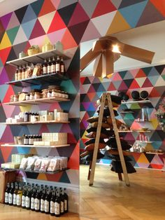boutique design -- triangles of color Brick And Mortar, Boutique Design, Retail Design, Visual Merchandising, Wine Rack, Interior Design, Interior Ideas, Shops, Wall Art